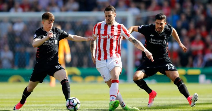Stoke-Citys-Geoff-Cameron-in-action-with-Liverpools-Emre-Can-and-Ben-Woodburn-v2